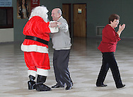 John DeMatteis of Pine Bush laughs after Santa Claus cut in while DeMatteis was dancing with Marie Neye, at right, of Wurtsboro during a Dancing with STARS sock hop in the high school cafeteria on Friday, Dec. 14, 2012. STARS stands for Students and Teachers for Academics Responsibility and Service.