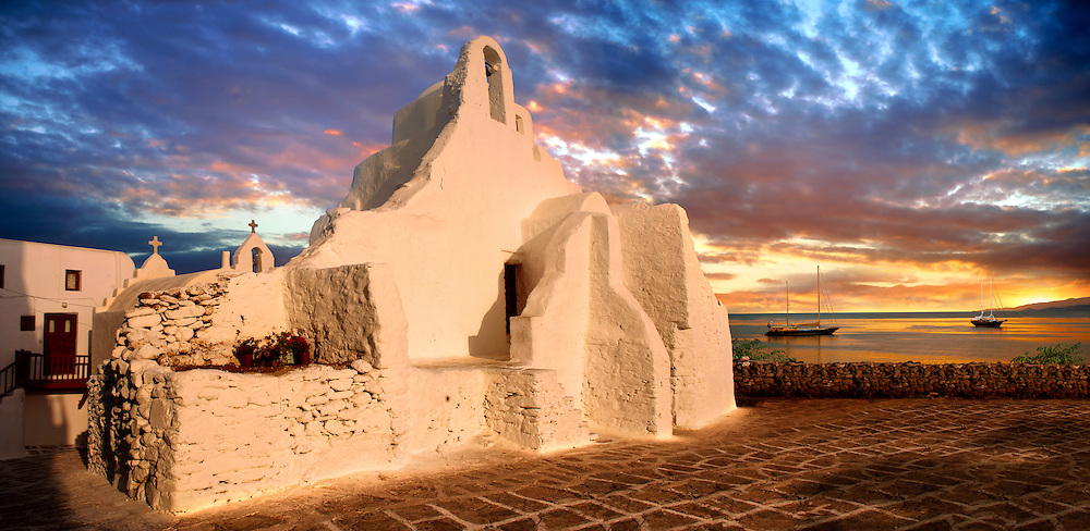 Sunset over the Paraportiani Greek Orthodox churches of Mykanos Chora, Cyclades Islands, Greece .<br /> <br /> Visit our GREEK HISTORIC PLACES PHOTO COLLECTIONS for more photos to download or buy as wall art prints https://funkystock.photoshelter.com/gallery-collection/Pictures-Images-of-Greece-Photos-of-Greek-Historic-Landmark-Sites/C0000w6e8OkknEb8