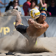 Chris McDonald makes the dig against Chase Fisherman in the AVP Huntington Beach Open