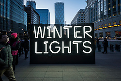 © Licensed to London News Pictures. 18/01/2020. LONDON, UK. Signage greens visitors to the sixth Winter Lights festival in Canary Wharf.  25 light art and interactive installations by international artists are on display for the public to enjoy until 25 January 2020.  Photo credit: Stephen Chung/LNP