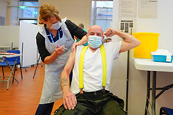 © Licensed to London News Pictures. 20/09/2021. Derby, UK. Senior Maintenance Carer Robert Lee receives the Covid-19 booster vaccine at Midland House in Derby. Photo credit: Ioannis Alexopoulos/LNP
