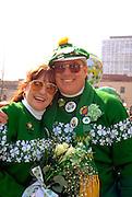 Irish couple age 50 celebrating at the St Patricks day parade.  St Paul  Minnesota USA