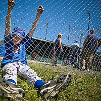 Saturday, June 14 , 2008 marked the final Evergreen Little League game after more than 50 years at Wineberg Park. The park is scheduled to be torn down for development. Colton Blake, 10, watches the last game start in dejection as his team, the Cubs, lost their match. Colton says he'll miss playing here next year.<br /> (The Columbian/ N. Scott Trimble)