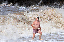 © Licensed to London News Pictures; 25/08/2020; Clevedon, UK. Storm Francis. A man swims in the sea at Clevedon during strong winds from Storm Francis which is hitting the UK with bad weather. Photo credit: Simon Chapman/LNP.