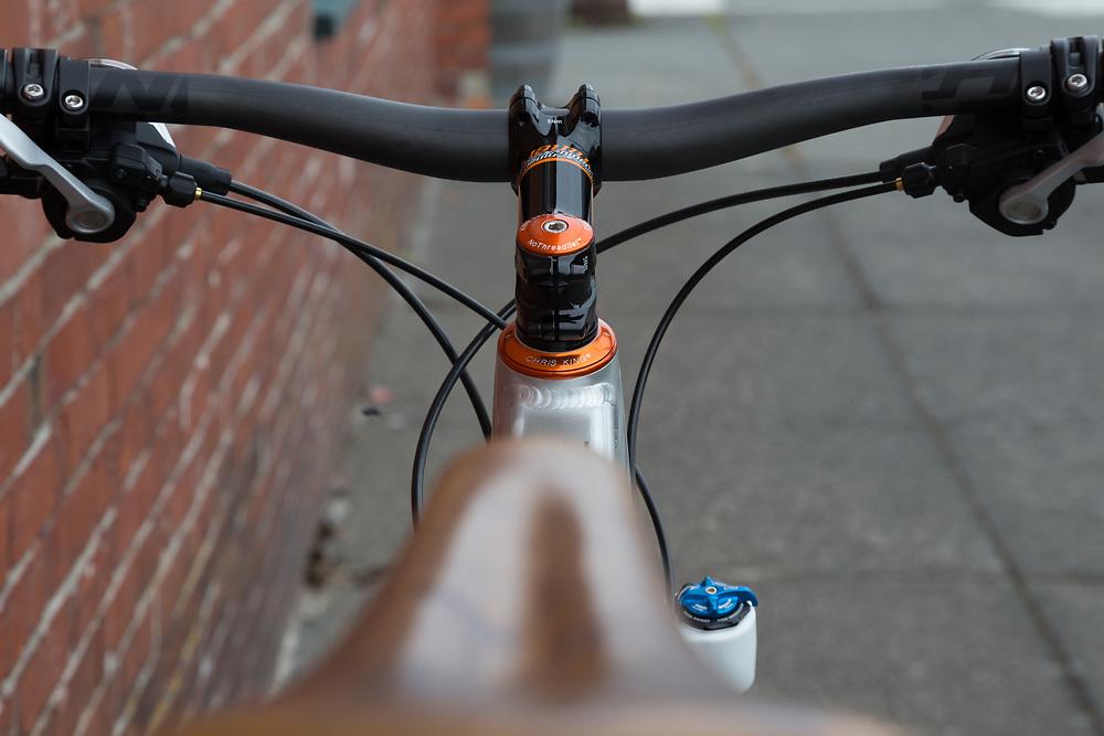 A Niner Rip 9 mountain bike set against a brick building wall in Anacortes, Washington.