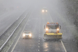 © Licensed to London News Pictures. 07/02/2021. Bredgar, UK. A now plough makes its way along the M2 motorway in Bredgar, Kent as parts of the south east of England are blanketed in snowfall from Storm Darcy. Photo credit: Peter Macdiarmid/LNP