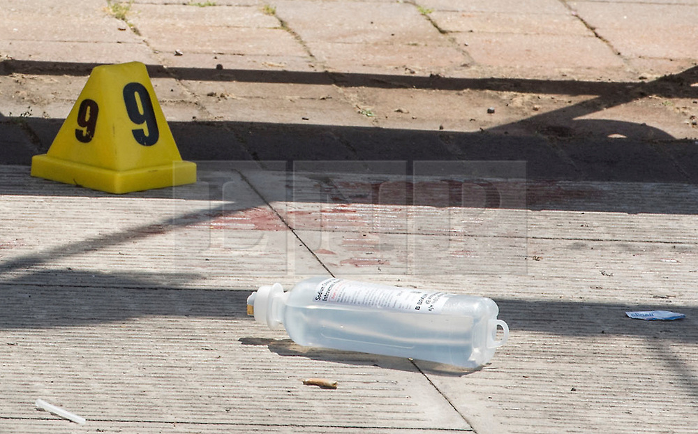 © Licensed to London News Pictures.  25/06/2018; Bristol, UK. Blood on the floor at a bus shelter near the scene of murder. A murder investigation has been launched after man dies and two are seriously injured in an armed burglary in Prewett Street, Redcliffe, in the early hours of the morning. It is reported that neighbours have told of hearing bloodcurdling screams of as three men were attacked with a sword-like knife. Two other men who suffered life-threatening injuries have been taken to hospital. It is reported that two men from London have been arrested in connection with the incident. Photo credit: Simon Chapman/LNP
