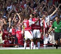 Photo: Richard Lane.<br />Arsenal v Everton. Barclaycard Premiership.<br />16/08/2003.<br />Robert Pires celebrates his goal.