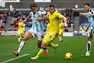 Chris Wood of Leeds United shields the ball from Emyr Huws of Huddersfield Town. Skybet football league Championship match, Huddersfield Town v Leeds United at the John Smith's Stadium in Huddersfield, Yorks on Saturday 7th November 2015.<br /> pic by Chris Stading, Andrew Orchard sports photography.