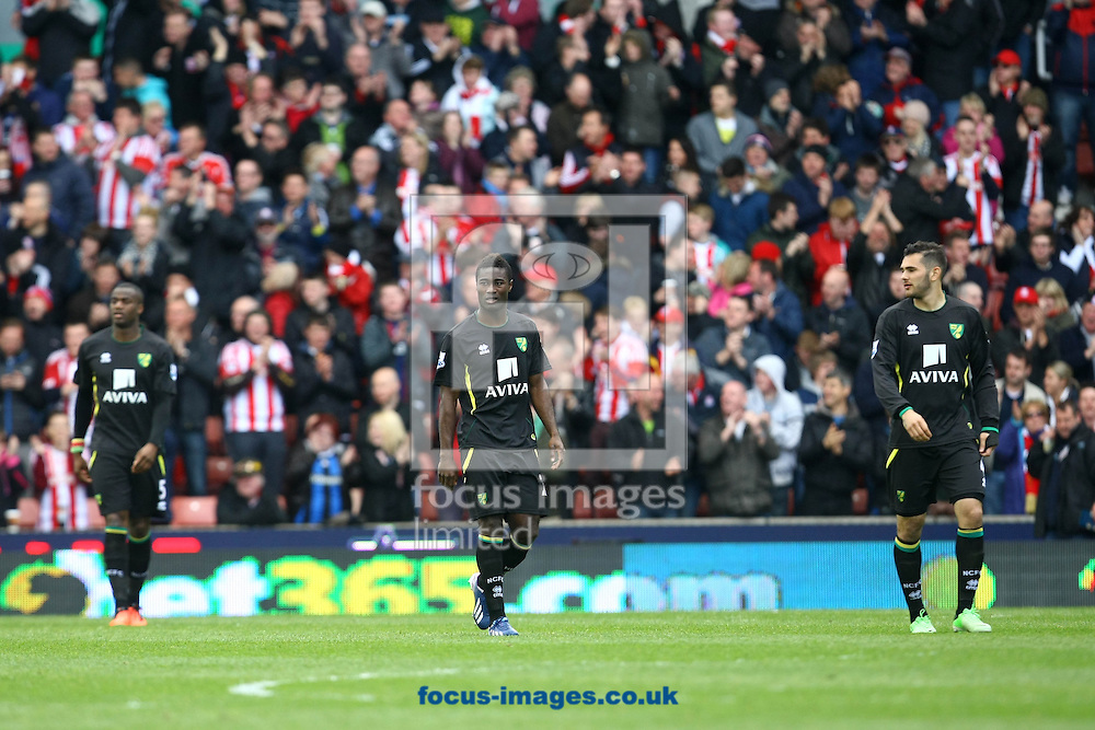 Picture by Paul Chesterton/Focus Images Ltd +44 7904 640267.27/04/2013.Sebastien Bassong of Norwich, Alexander Tettey of Norwich and Bradley Johnson of Norwich look dejected after Stoke open the scoring during the Barclays Premier League match at the Britannia Stadium, Stoke-on-Trent.