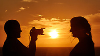 Sunrise Breakfast Club. Silhouette Photographer at Sunrise. Image taken with a Nikon 1 V3 camera and 70-300 mm VR lens