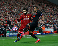 Mohamed Salah of Liverpool tackled by Renan Lodi of Atletico Madrid  during the UEFA Champions League match at Anfield, Liverpool. Picture date: 11th March 2020. Picture credit should read: Darren Staples/Sportimage