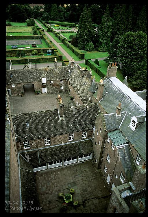 Overview of private, east wing of Glamis Castle, with Italian Garden in upper right, from atop castle roof; Glamis, Scotland.