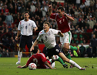 Photo: Paul Thomas.<br /> England v Hungary. International Friendly. 30/05/2006.<br /> <br /> Steven Gerrard of England (C) is fouled by Hungarian Casba Feher (2) inside the penalty area.