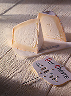 """2 halves of Pyramid Chevre cheese with """"pur Chevre"""" sign"""