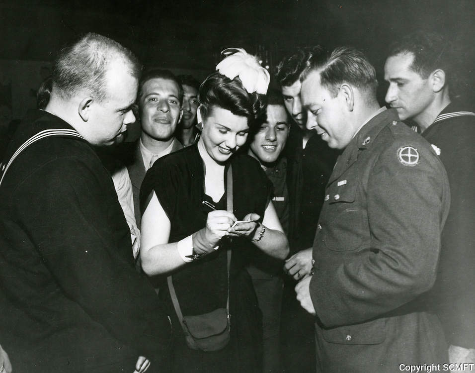 1943 Deanna Durbin signing autographs at the Hollywood Canteen