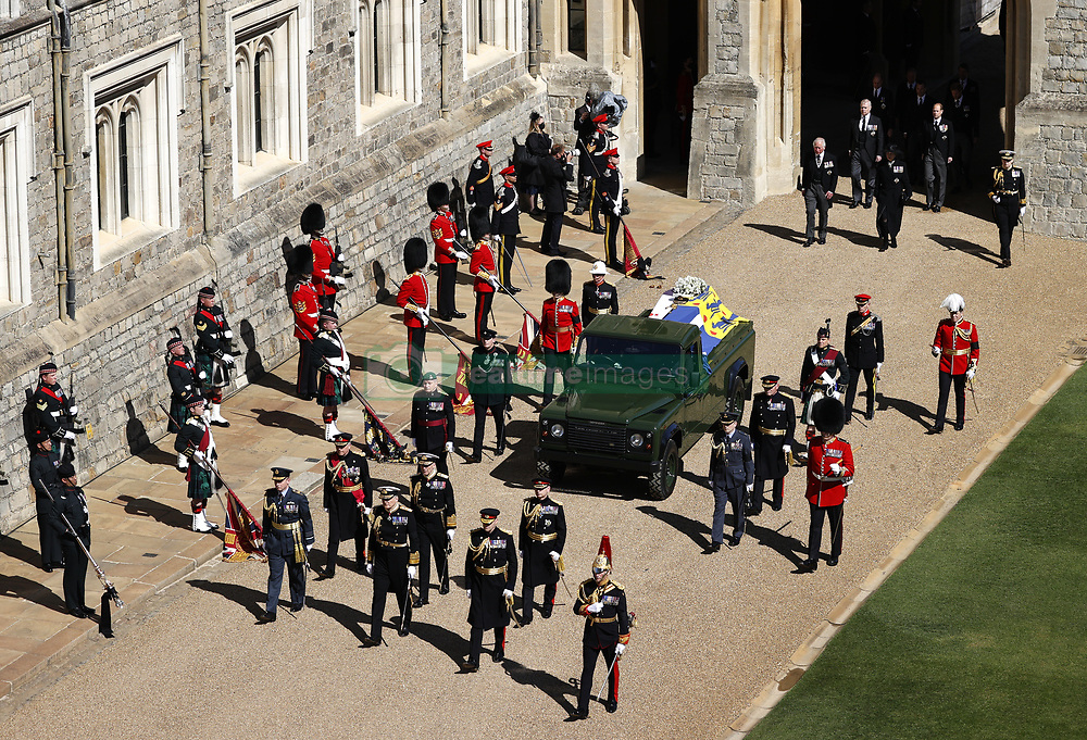 The Prince of Wales, the Duke of York, the Princess Royal, and the Earl of Wessex, follow the Duke of Edinburgh's coffin, covered with his Personal Standard, on the purpose built Land Rover Defender during the Ceremonial Procession ahead of the funeral of the Duke of Edinburgh in Windsor Castle, Berkshire. Picture date: Saturday April 17, 2021.