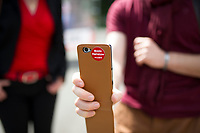 DEU, Deutschland, Germany, Stadtroda, 23.08.2014: Ein Unterstützer der Linken mit seinem Handy mit Bodo-Ramelow-Aufkleber bei einer Wahlveranstaltung der Linkspartei in Stadtroda.