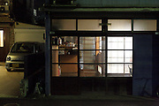 old style Japanese residential house with modern car and garage
