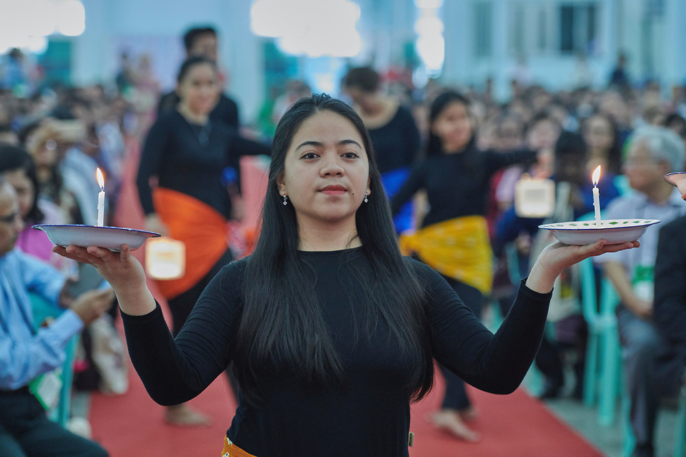 Kristiani Pangau, a liturgical dancer from Indonesia, carries candles during the opening procession of the Asia Mission Conference in Yangon, Myanmar, on October 12, 2017.