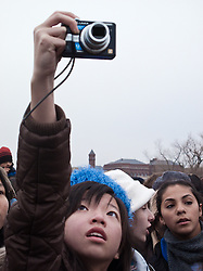 Girl in audience taking photographs at Inaugural Concert for Barack Obama, the Mall, Washington D.C., USA.