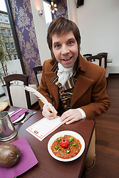 Robert Burns lookalike Chris Tait samples controversial.restaurant Kismot's new Burn's Day haggis curry, with Abdul Ali from Kismot. Signing the Kismot killer curry disclaimer..Pic © Michael Schofield...
