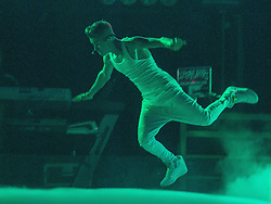 "© Licensed to London News Pictures . FILE PICTURE DATED 21/02/2013 of Canadian pop star JUSTIN BIEBER leaping across the stage at the Manchester Arena , UK , on the opening night of his UK "" Believe "" tour , as a spokeswoman last night (7th March) reported Bieber had to take an unscheduled break during a show at the O2 Arena last night (7th March). Bieber was said to have fainted and had to be treated by doctors with oxygen before returning to the stage . Photo credit : Joel Goodman/LNP"