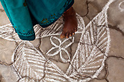An elderly woman's foot on decorative Rangoli at the Tamaraikulum Elders village, Tamil Nadu, India