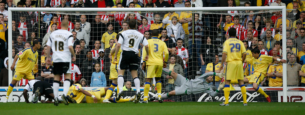 Photo: Steve Bond.<br />Derby County v Southampton. Coca Cola Championship. Play Off Semi Final, 2nd Leg. 15/05/2007. Darren Moore (left, ground) beats keeper Kelvin Davies with an early header