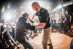 Tommy Blom shows students with the next knife defence exercise. IKMS 'In The Club' seminar with KMG Global Team Instructor and Expert Level 5, Tommy Blom, at the Buff Club in Glasgow's City Centre. Bringing Krav Maga training out with the confines of the gym into a real nightclub/bar.<br /> © Michael Schofield.