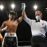 Alex Vargas celebrates a victory over Jorge Careaga during a One For All Promotions boxing event at the Caribe Royale Orlando Events Center on Saturday, February 20, 2021 in Orlando, Florida. (Alex Menendez via AP)
