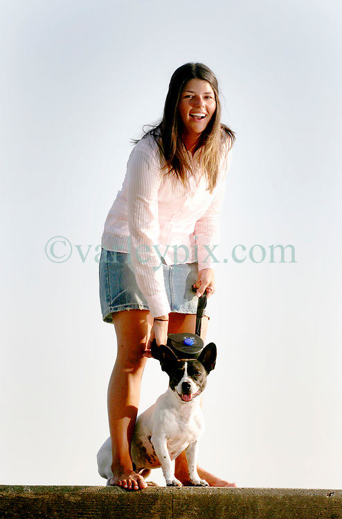 May 24th, 2006. Mandeville, Louisiana. USA.<br /> Katrina Rescue. Gabrielle Garner (24 yrs) with her parents' dog Boudreaux. Gabrielle returned to rescue her dog from a local vet on Sept 1st, immediately after Hurricane Katrina struck the area.<br /> Photo ©; Charlie Varley/varleypix.com
