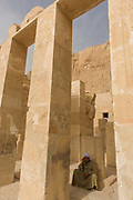 "A local guide at the otherwise deserted ancient Egyptian Temple of Hatshepsut near the Valley of the Kings, Luxor, Nile Valley, Egypt. According to the country's Ministry of Tourism, European visitors to Egypt is down by up to 80% in 2016 from the suspension of flights after the downing of the Russian airliner in Oct 2015. Euro-tourism accounts for 27% of the total flow and in total, tourism accounts for 11.3% of Egypt's GDP. The Mortuary Temple of Queen Hatshepsut, the Djeser-Djeseru, is located beneath cliffs at Deir el Bahari (""the Northern Monastery""). The mortuary temple is dedicated to the sun god Amon-Ra and is considered one of the ""incomparable monuments of ancient Egypt."" The temple was the site of the massacre of 62 people, mostly tourists, by Islamists on 17 November 1997."