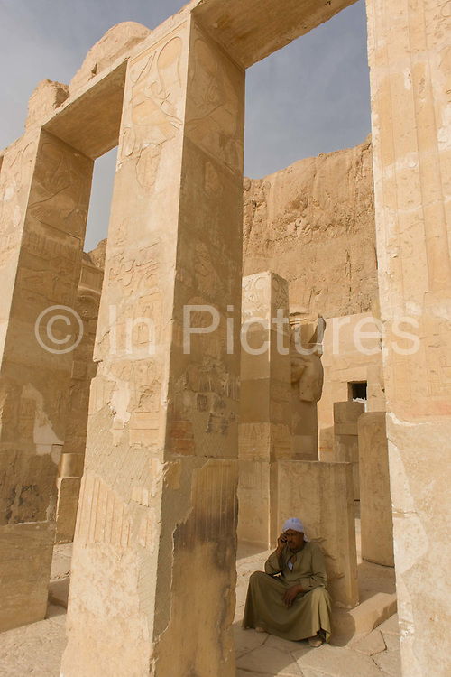 """A local guide at the otherwise deserted ancient Egyptian Temple of Hatshepsut near the Valley of the Kings, Luxor, Nile Valley, Egypt. According to the country's Ministry of Tourism, European visitors to Egypt is down by up to 80% in 2016 from the suspension of flights after the downing of the Russian airliner in Oct 2015. Euro-tourism accounts for 27% of the total flow and in total, tourism accounts for 11.3% of Egypt's GDP. The Mortuary Temple of Queen Hatshepsut, the Djeser-Djeseru, is located beneath cliffs at Deir el Bahari (""""the Northern Monastery""""). The mortuary temple is dedicated to the sun god Amon-Ra and is considered one of the """"incomparable monuments of ancient Egypt."""" The temple was the site of the massacre of 62 people, mostly tourists, by Islamists on 17 November 1997."""