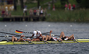 Trakai, LITHUANIA.  GER JW4X Silver Medalist.  Bow, Antje DRESSLER, Elin HOPPE, Kristin MAEUSEZAHL and Josephine WARTENBERG. exhausted after the fianl of the junior women's quadruple sculls at the  2002 Junior World Rowing Championships, on Lake Galva Wednesday  07/08/2002 [Mandatory Credit: Peter Spurrier/ Intersport Images]. 200208 Junior World Rowing Championships, Trakai, LITHUANIA