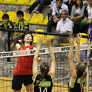 Fenerbahce's Eda Erdem (N14), Elif Agca Oner and Vakifbank's Saori Kimura (L) during their Turkish Woman Volleyball friendly match Fenerbahce between  Vakifbank at Haldun Alagas Arena in Istanbul, Turkey on 05 October 2012. Photo by Aykut AKICI/TURKPIX