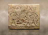 Photo of Hittite sculpted orthostats of Long Wall Limestone, Karkamıs, (Kargamıs), Carchemish (Karkemish), 900-700 BC. Anatolian Civilisations Museum, Ankara, Turkey<br /> <br /> Soldiers. Figure of three helmeted warriors. They have their shield in their back and their spear in their hand. The prisoners in their front are depicted as small. The lower part of the orthostat is decorated with wring / braiding motifs.<br /> <br /> On a brown art background. .<br />  <br /> If you prefer to buy from our ALAMY STOCK LIBRARY page at https://www.alamy.com/portfolio/paul-williams-funkystock/hittite-art-antiquities.html  - Type  Karkamıs in LOWER SEARCH WITHIN GALLERY box. Refine search by adding background colour, place, museum etc.<br /> <br /> Visit our HITTITE PHOTO COLLECTIONS for more photos to download or buy as wall art prints https://funkystock.photoshelter.com/gallery-collection/The-Hittites-Art-Artefacts-Antiquities-Historic-Sites-Pictures-Images-of/C0000NUBSMhSc3Oo