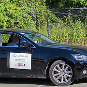 August 19, 2014, New Haven, CT:<br /> A volunteer drives a Lexus on day five of the 2014 Connecticut Open at the Yale University Tennis Center in New Haven, Connecticut Tuesday, August 19, 2014.<br /> (Photo by Billie Weiss/Connecticut Open)