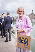 """@Licensed to London News Pictures 07/09/15. Ramsgate, Kent. Councillor and Deputy Mayor for Ramsgate Sarah Larkin holds the Ukip Party """"Say No To The EU"""" Tour leaflet. Nigel Farage Leader of the UKIP Party  goes on walkabout today to launch his party's """"Say No To The EU"""" Tour in Ramsgate town centre. Photo credit: Manu Palomeque/LNP"""