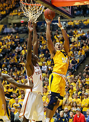 Jan 20, 2018; Morgantown, WV, USA; West Virginia Mountaineers forward Sagaba Konate (50) shoots during the second half against the Texas Longhorns at WVU Coliseum. Mandatory Credit: Ben Queen-USA TODAY Sports