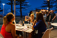 Women dining outside at China Beach Restaurant, Manly Beach, Sydney, New South Wales, Australia