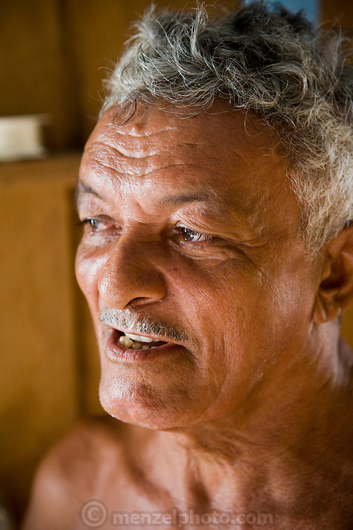 Brazilian fisherman João Agustinho Cardoso at his floating home on the Salimones River in near the town of Manacapuru, Brazil.  (João Agustinho Cardoso da Silva is featured in the book What I Eat: Around the World in 80 Diets.)