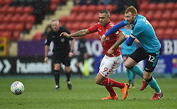 Charlton Athletic's Josh Magennis and Fleetwood Town's Cian Bolger battle for the ball