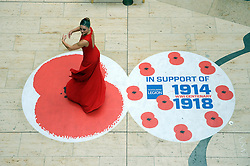 © Licensed to London News Pictures. 26/10/2014<br /> Ballet dancer. <br /> Bluewater joins forces with the Royal British Legion to remember In the year that marks 100 years since the birth of the poppy as a symbol of Remembrance and hope, Bluewater is supporting the Royal British Legion's Poppy Appeal campaign with a two-week mall takeover, beginning with the formal launch of the Poppy Appeal in Kent. The 26th October will see an external parade of 150 people, including standard bearers, veterans, serving personnel, reserves, cadets, Scouts and Brownies joining the Royal British Legion in a procession around Bluewater. Also attending the parade will be Gareth Johnson, MP for Dartford, Councillor Avtar Sandhu MBE, the Mayor of Dartford, and Councillor John Caller, the Mayor of Gravesham. Concluding the launch of the Poppy Appeal at 12:20pm will be a performance by Gareth Malone's Military Wives Choir, from Brompton Barracks in Chatham. The Military Wives will sing in Bluewater's Plaza (outside Glow) before the Royal British Legion leads a spoken tribute and minute's silence. From then until 11th November, when there will be a Remembrance Day memorial silence, the Royal British legion will be stationed at an in-mall collection point on the lower Thames Walk fundraising for the charity.<br /> <br /> (Byline:Grant Falvey/LNP)