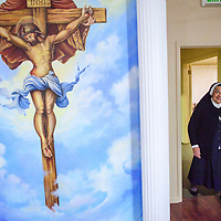 Mother Magda Garcia enters the newly remodeled chapel of Our Lady of Guadalupe and St. Joseph in Gallup Tuesday. The convent, chapel and headquarters relocated to the former Diocese of Gallup's chancery building after a California physician who had the building remodeled and donated to Mother Magda and her sisters.
