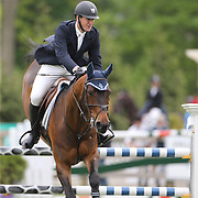 Mclain Ward riding HH Carlos Z in action during the $35,000 Grand Prix of North Salem presented by Karina Brez Jewelry during the Old Salem Farm Spring Horse Show, North Salem, New York, USA. 15th May 2015. Photo Tim Clayton