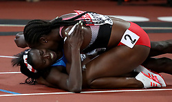 USA's Tori Bowie (bottom) celebrates with Trinidad and Tobago's Kelly-Ann Baptiste after winning gold in the Women's 100m Final during day three of the 2017 IAAF World Championships at the London Stadium.