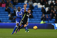 Sam Baldock of Brighton  is challenged by Sol Bamba of Cardiff city. EFL Skybet championship match, Cardiff city v Brighton & Hove Albion at the Cardiff city stadium in Cardiff, South Wales on Saturday 3rd December 2016.<br /> pic by Andrew Orchard, Andrew Orchard sports photography.