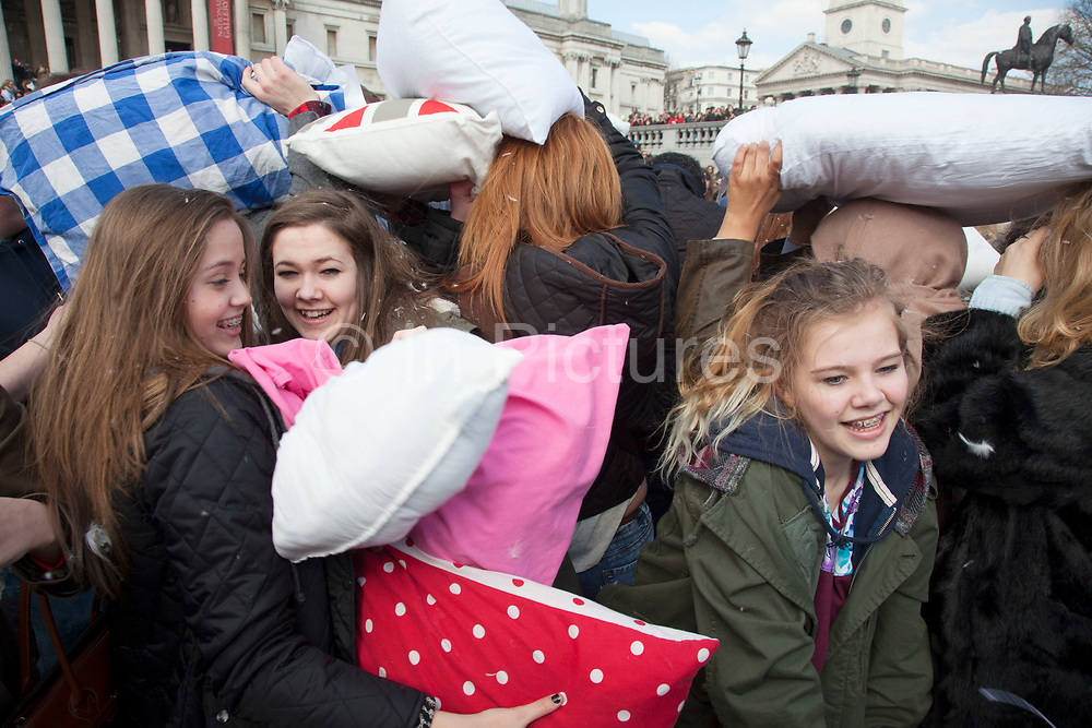 London, UK. Saturday 6th April 2013. World Pillow Fight Day in London, UK. People having fun in London's mass feathery fracas taking place in Trafalgar Square. This flashmob event is organised by the Urban Playground Movement. A pillow fight flash mob is a social phenomenon of flash mobbing and shares many characteristics of a culture jam.
