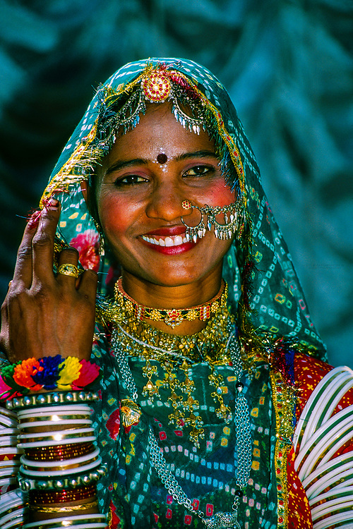 Rajasthani woman covered in jewelry, Pushkar Fair (camel fair), Rajasthan, India